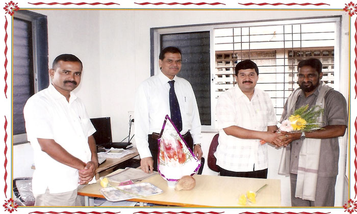 felicitation of Mr.Borade. Manager BOI.